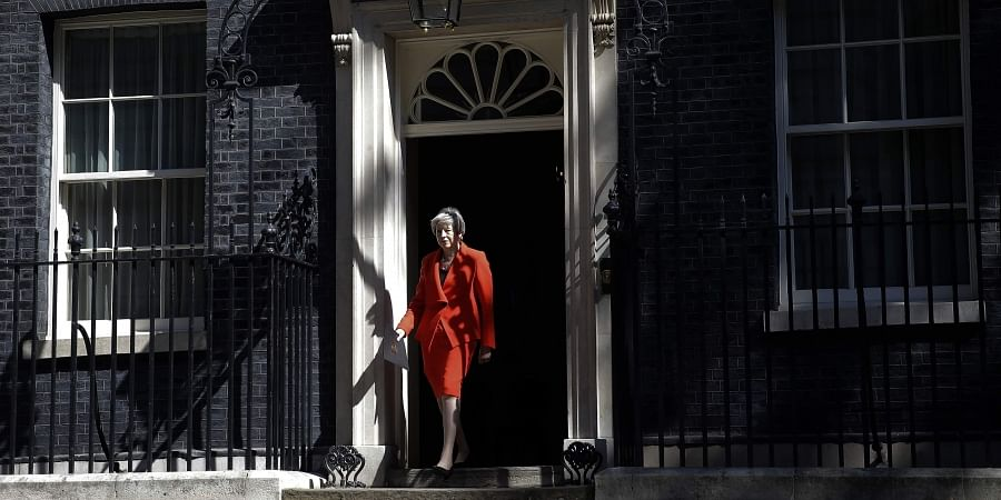 British Prime Minister Theresa May walks walks out to make a speech outside 10 Downing Street in London, England on 24 May 2019. (Photo | AP)