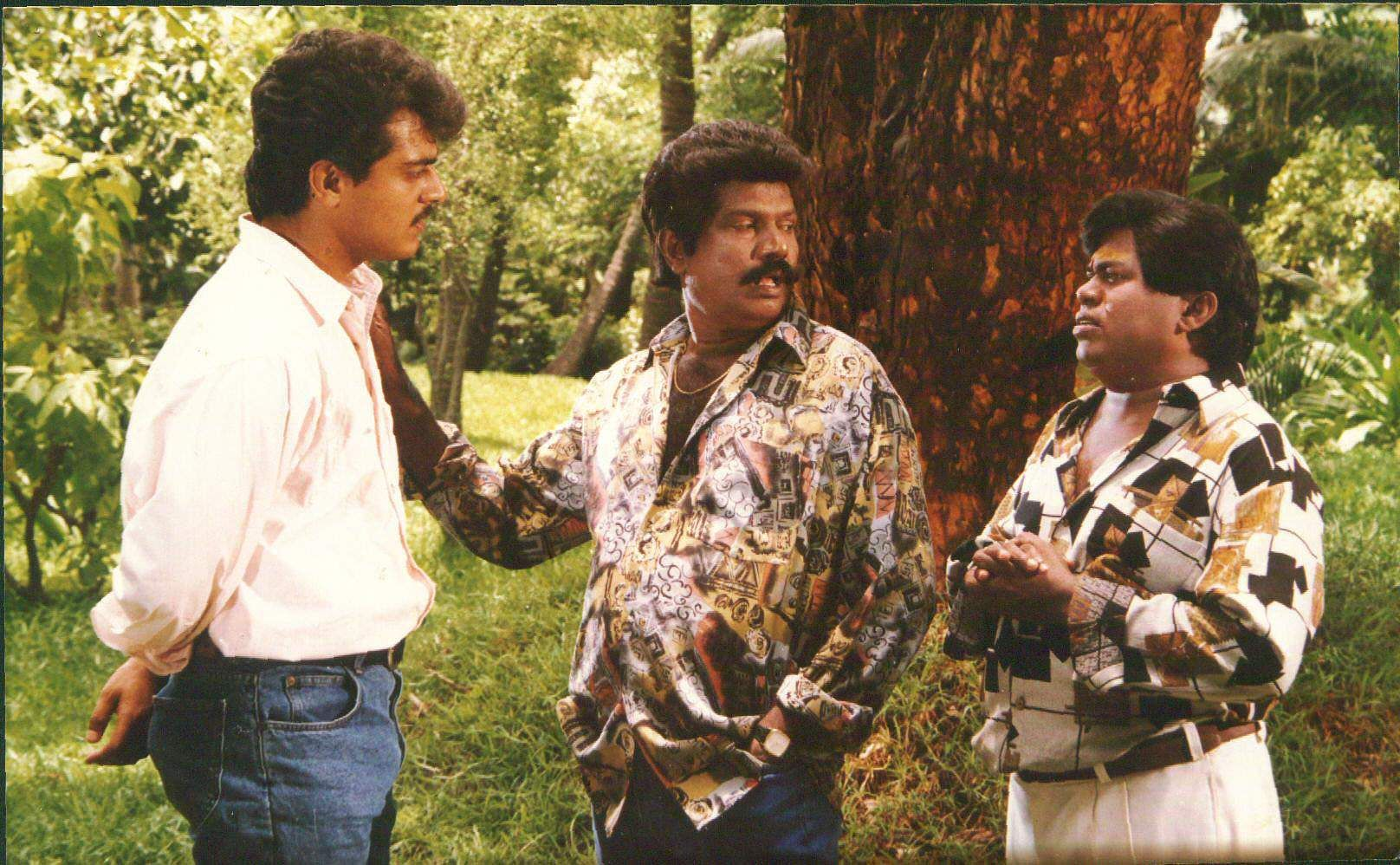 Actor Goundamani is seen here with ultimate star Ajith Kumar (L) and actor Senthil (R).