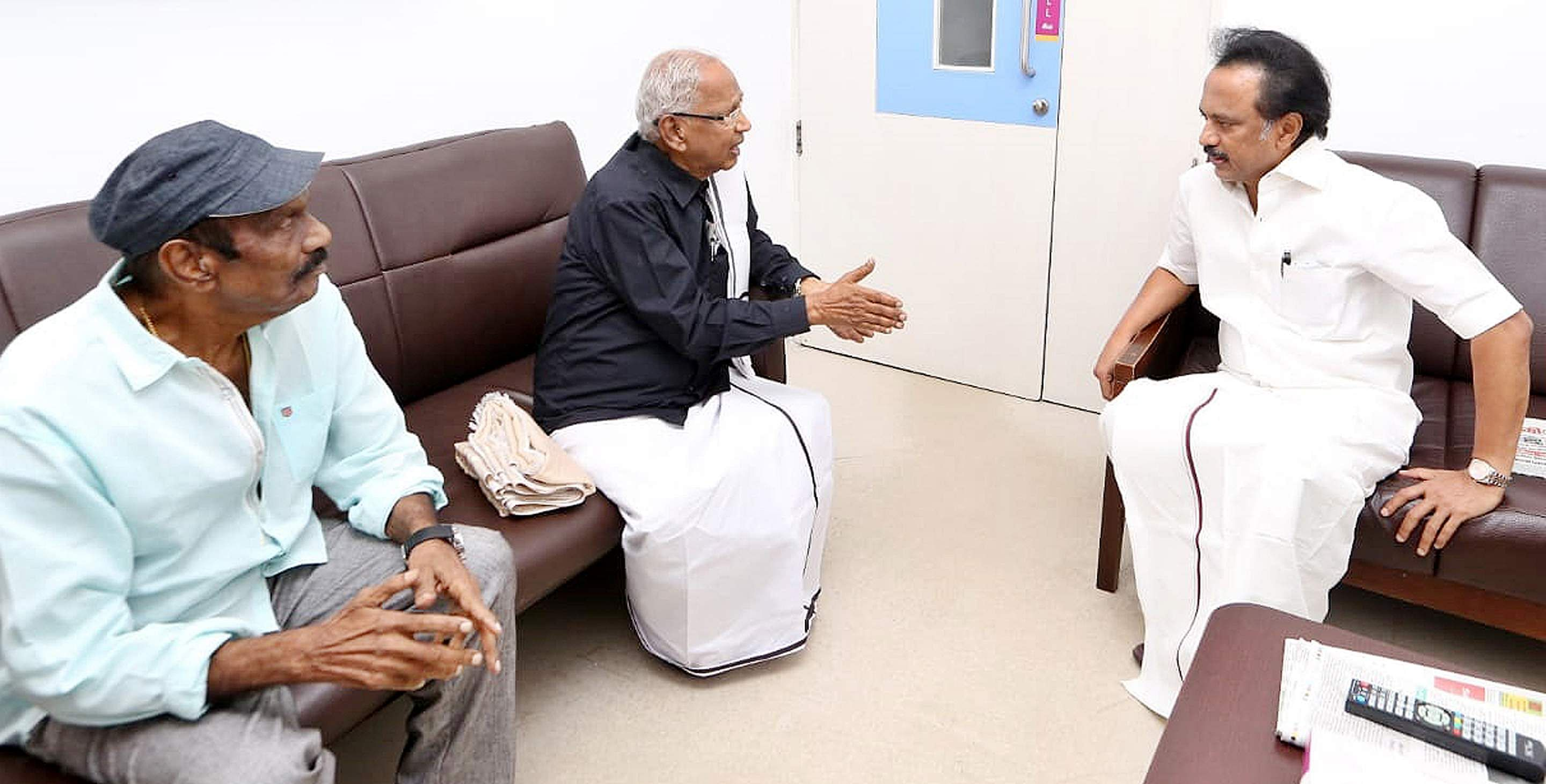 Dravidar Kazhagam President K Veeramani (C) and actor Goundamani meet DMK President MK Stalin (R) to enquire about the health of DMK President M Karunanidhi who is recovering after hospitalisation at Kauvery hospital in Chennai.