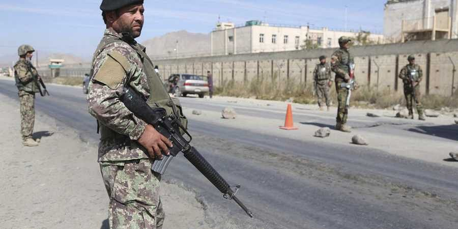 Afghan National Army soldiers stand guard at a checkpoint in Kabul
