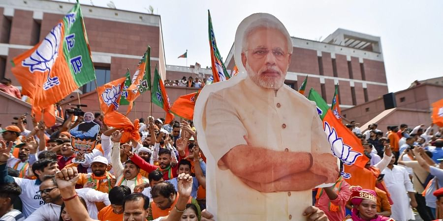 BJP supporters carry a cut-out of PM Narendra Modi as they celebrate the party's victory in the 2019 Lok Sabha elections in New Delhi. (Photo | PTI)