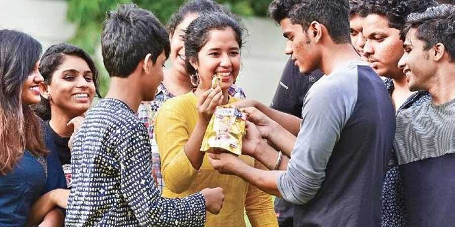 Students of Greets Public School, Kaloor, distribute sweets after verifying results | Albin Mathew