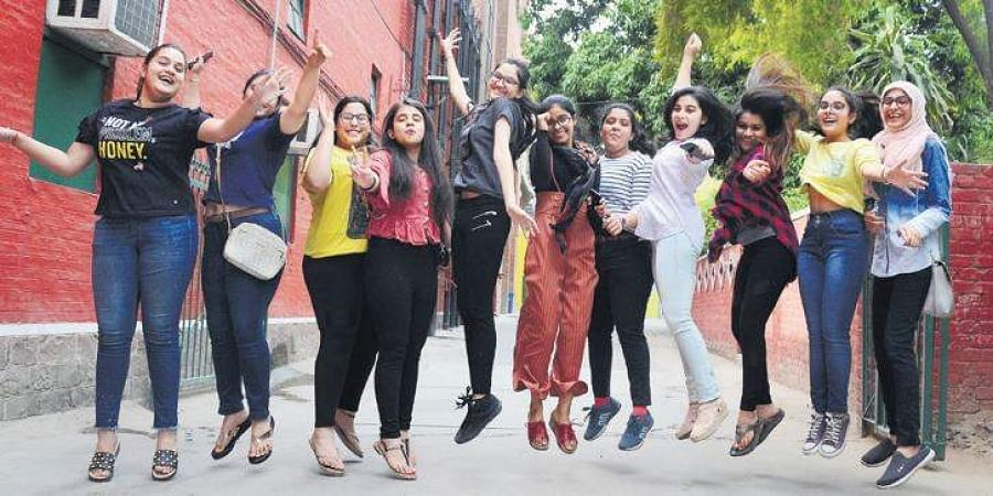 Students in New Delhi celebrate after checking the results, on Thursday | Naveen Kumar