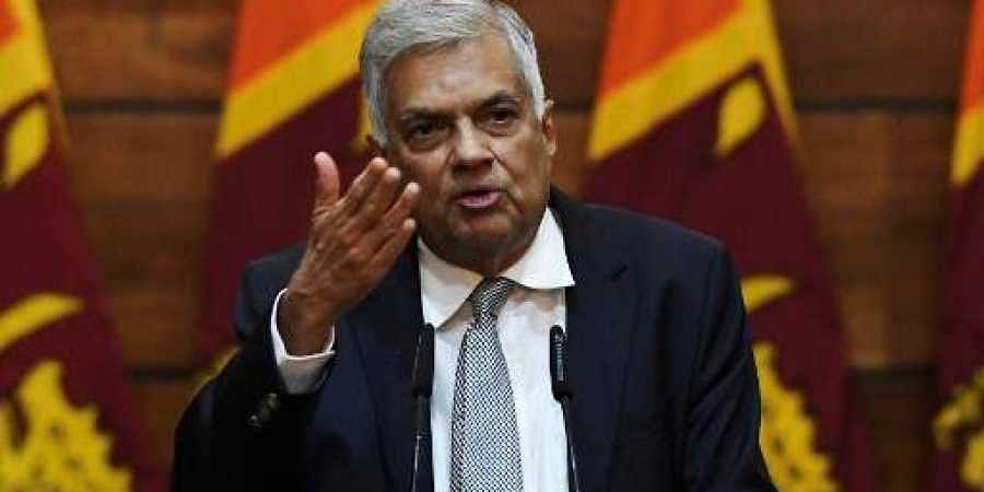Prime Minister of Sri Lanka Ranil Wickremesinghe gestures as he answers questions from a journalist during a press conference in Colombo