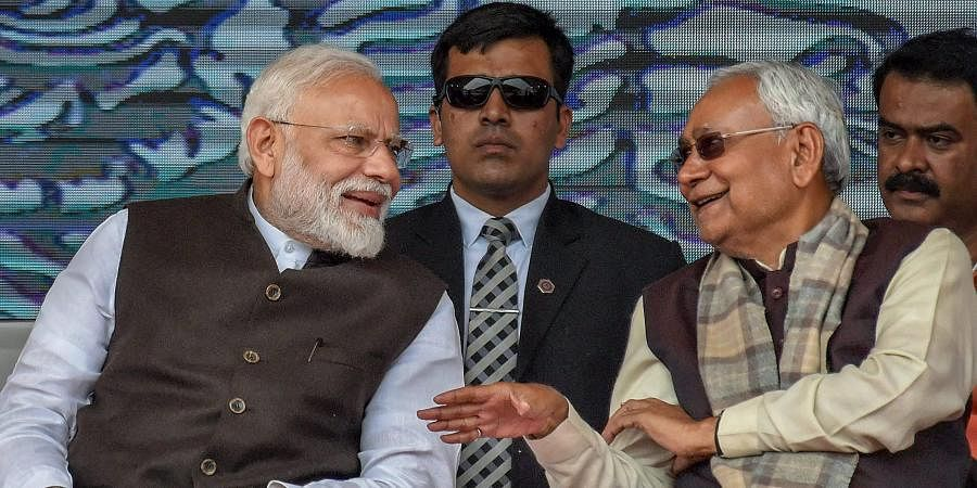 PM Narendra Modi (L) and Bihar CM Nitish Kumar