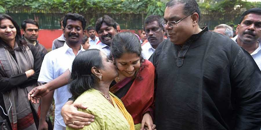 DMK MP Kanimozhi celebrates with her husband G Aravindan and mother Rajathi Ammal after she was acquitted by a special court in the 2G scam case in New Delhi on Thursday. | PTI