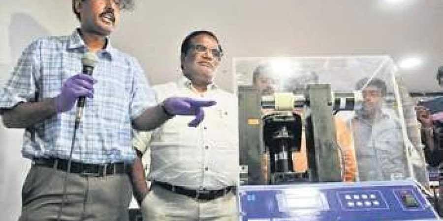 Professor Surajit Dhara demonstrates the working of the rubbing machine