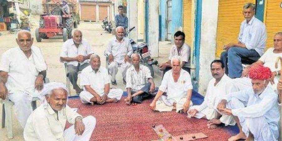 A group of old men playing 'choupad pasa' in Ganeshpura village of Rajasthan's Dausa constituency