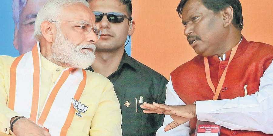 Prime Minister Narendra Modi and former Jharkhand chief minister Arjun Munda during an election rally in the state. Munda is the BJP candidate from Khunti