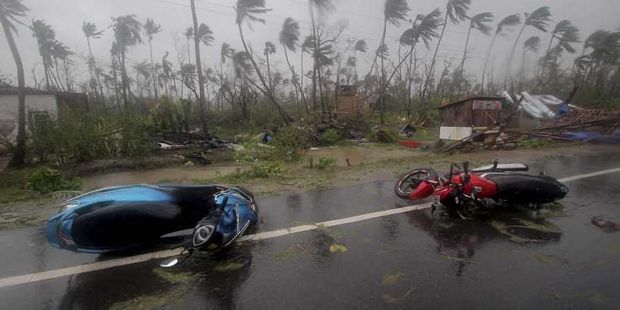 Motorcycles lie on a street in Puri district after Cyclone Fani hit
