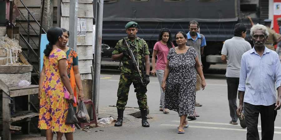A Sri Lankan police commando secures the area of exploded St. Anthony's Church on Easter Sunday attacks in Colombo