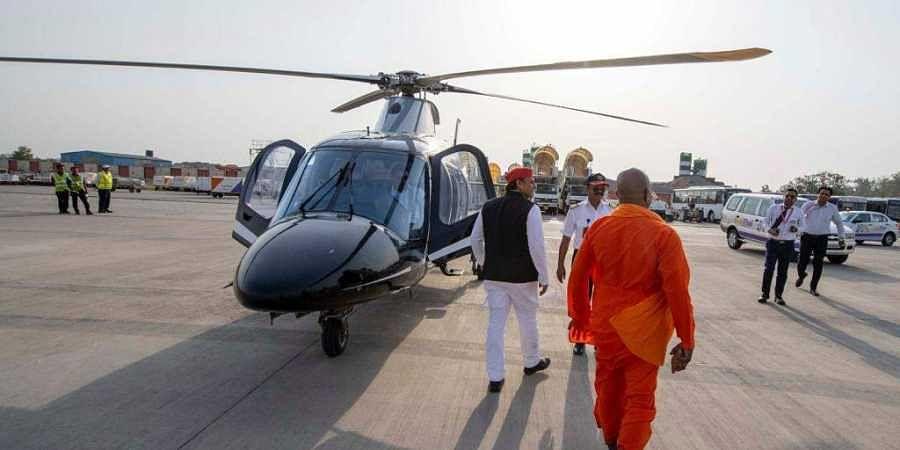 Former Uttar Pradesh CM Akhilesh Yadav with a bab resembling Yogi Adityanath. (Photo | Akhilesh Yadav Twitter)