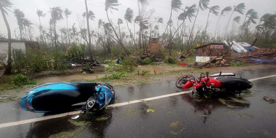 Motorcycles lie on a street in Puri district after Cyclone Fani hit the coastal Odisha.