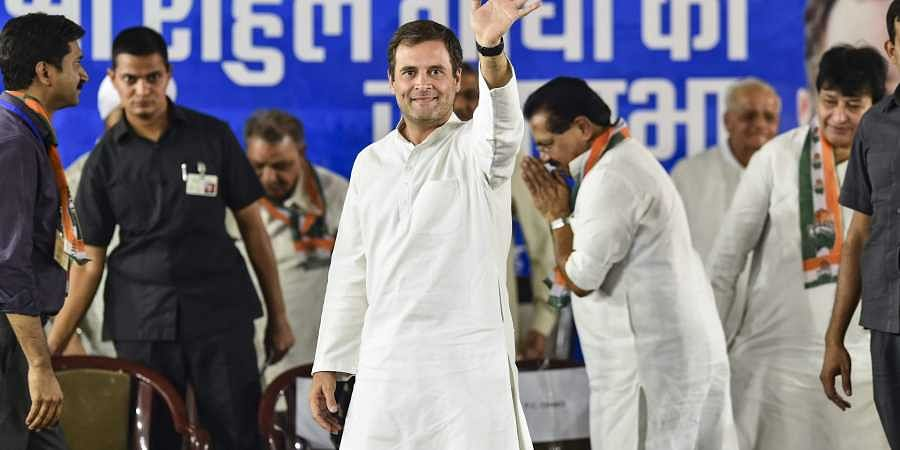 Congress President Rahul Gandhi waves at his supporters during an election campaign rally for the Lok Sabha polls in New Delhi