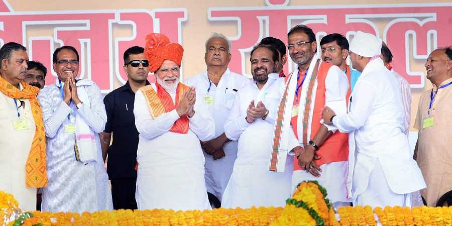 Prime Minister Narendra Modi with former Madhya Pradesh chief minister Shivraj Singh Chouhan and other leaders during a public meeting for the Lok Sabha polls