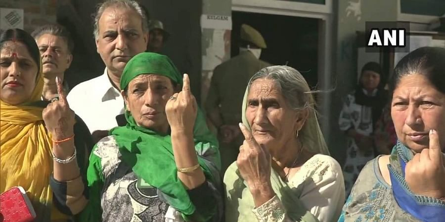 Kashmiri Pandits cast their votes at a Special Polling Station in Udhampur, for Anantnag parliamentary constituency.