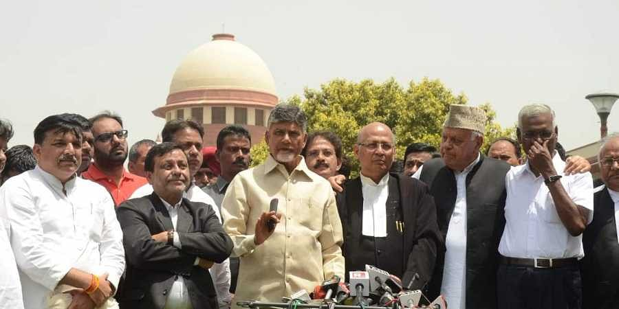 Opposition leaders Chandrababu Naidu, Abhishek Manu Singhvi, Farooq Abdullah, D Raja, Sanjay Singh and others addressing the media after the Supreme Court rejected a review plea seeking an increase in random matching of VVPAT slips with EVMs, in New Delhi on 7 May 2019. (Photo | Naveen Kumar, EPS)