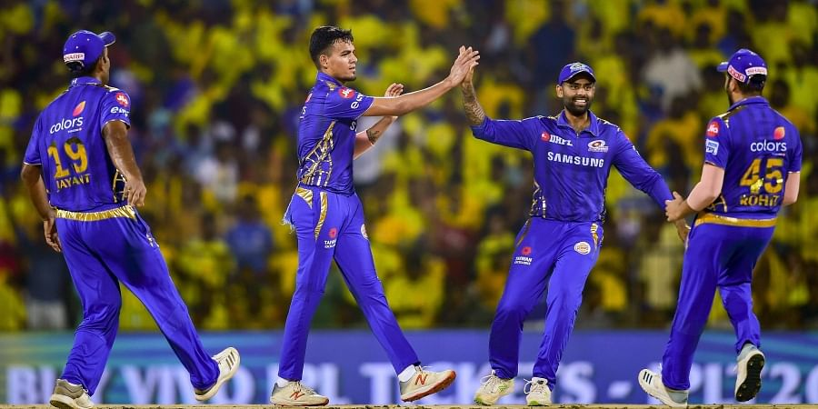 Mumbai Indian bowler Rahul Chahar celebrates with teammates after dismissing Chennai Super Kings batsman Faf du Plessis during the First Qualifier cricket match of Indian Premier League 2019. (Photo | PTI)