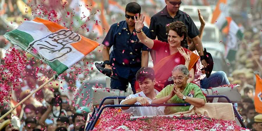 Priyanka Gandhi Vadra with the party's North East Delhi candidate Sheila Dikshit during an election roadshow for the Lok Sabha polls in North East Delhi