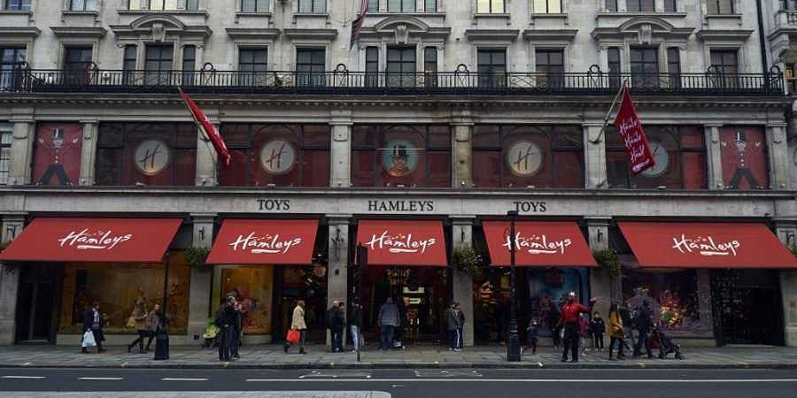 People walk past The Hamleys toy store on Regent Street in central London