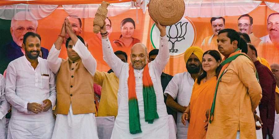 BJP National President Amit Shah during an election rally in support of party candidate from Sultanpur constituency Maneka Gandhi for the ongoing Lok Sabha polls in Sultanpur