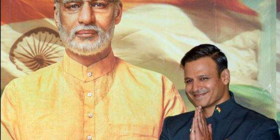 Bollywood actor Vivek Oberoi poses for photos after the poster launch of Prime Minister Narendra Modi's biopic in Mumbai
