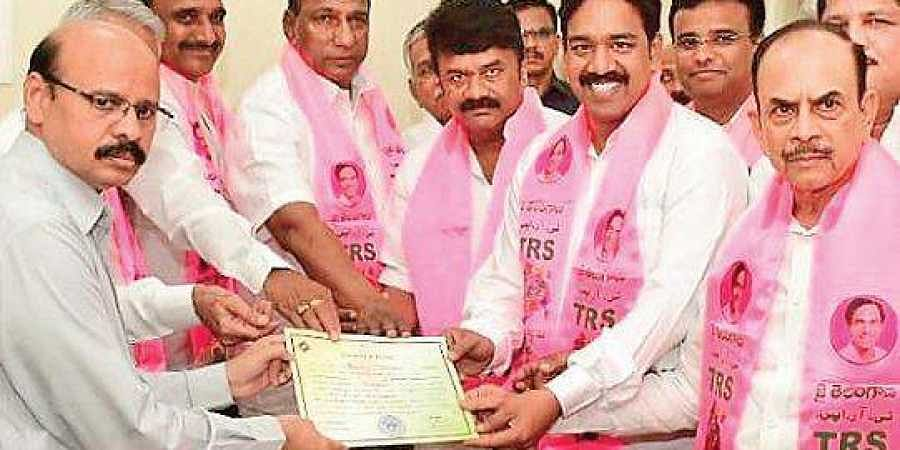 K Naveen Kumar receives the certificate from Telangana Assembly Secretary  V Narasimha Charyulu after he was unanimously elected as an MLC