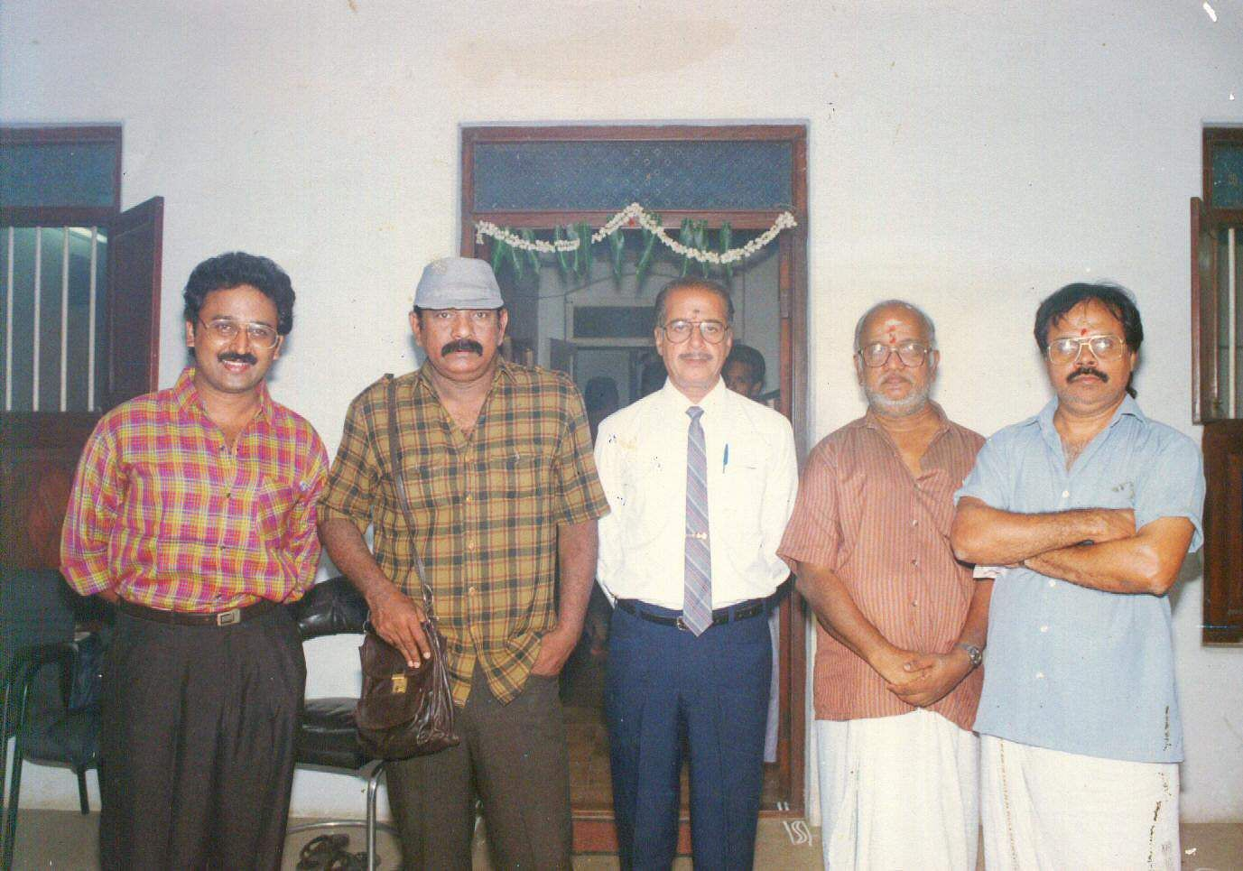 Tamil Film Director Balu Mahendra (second left) with actor Ramesh Aravind (L) and screenplay writer Crazy Mohan (extreme right) at a function.