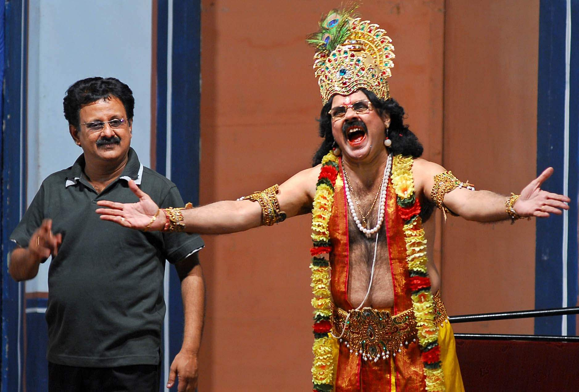Crazy Mohan (R) as Krishna and Balaji in Crazy Mohan play Chocolate Krishna held at Rani Seethai Hall in Chennai.
