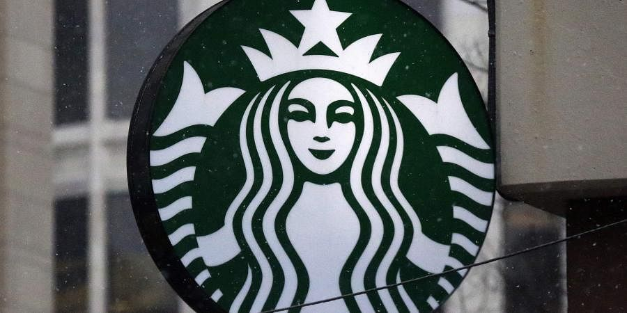 Starbucks logo on a shop in downtown Pittsburgh. (Photo | AP)