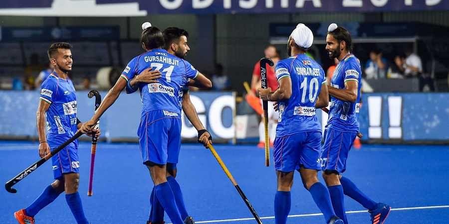 Indian hockey captain Manpreet Singh celebrates with his teammates after scoring a goal against Poland during FIH Men's Series Finals 2019 at Kalinga Stadium in Bhubaneswar. (Photo | PTI)