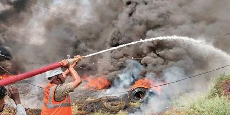 Firefighters use a water cannon to douse fire at a scrap yard in Auto Nagar in the city on Sunday.