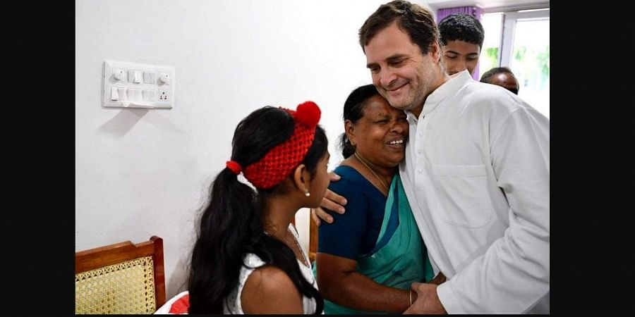 Congress President Rahul Gandhi hugs Rajamma, who was his delivery nurse at a hospital in Delhi way back in 1970. (Photo | By Special Arrangement)