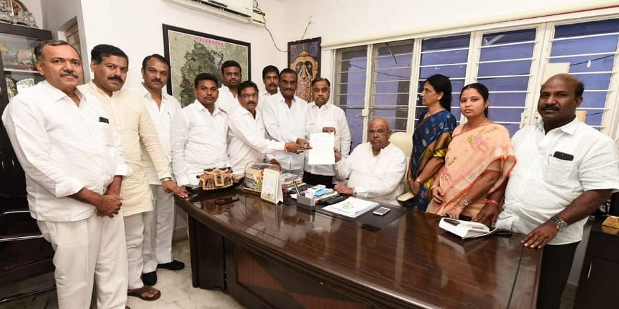 The 12 Congress MLAs who defected to the TRS are seen with state legislative assembly speaker Pocharam Srinivas Reddy at his residence in the Ministers' Quarters in Hyderabad on 6 June 2019. They submitted a representation seeking to merge the Congress Legislature Party with the ruling TRS. (Photo | EPS)