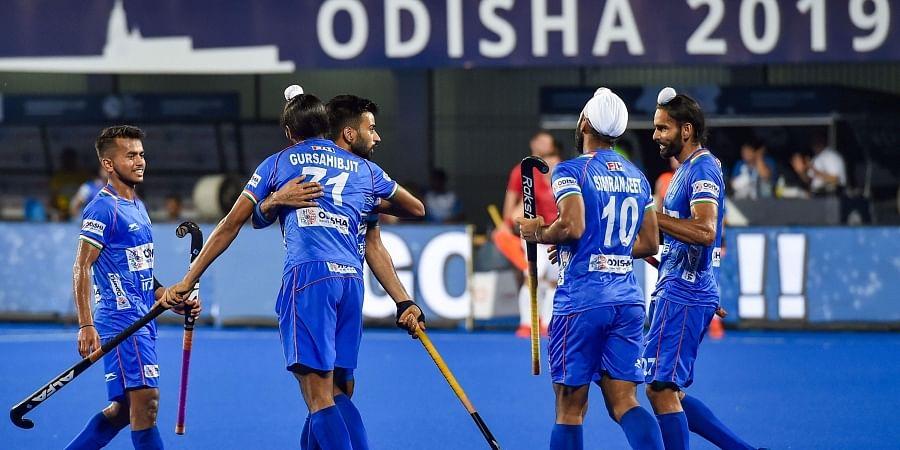 Indian hockey captain Manpreet Singh celebrates with his teammates after scoring a goal against Poland during FIH Men's Series Finals 2019 at Kalinga Stadium in Bhubaneswar.