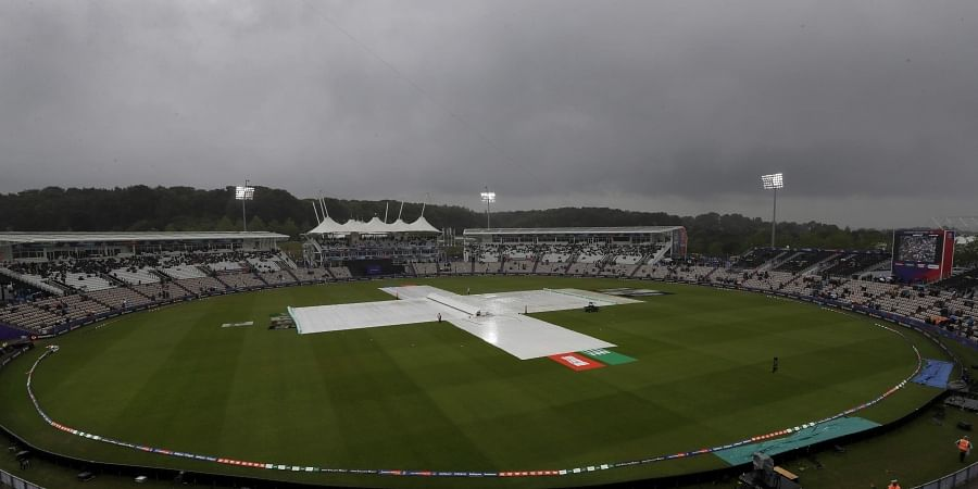 Rain covers on the pitch after play was stopped due to rain during the World Cup cricket match between South Africa and the West Indies at The Ageas Bowl in Southampton.