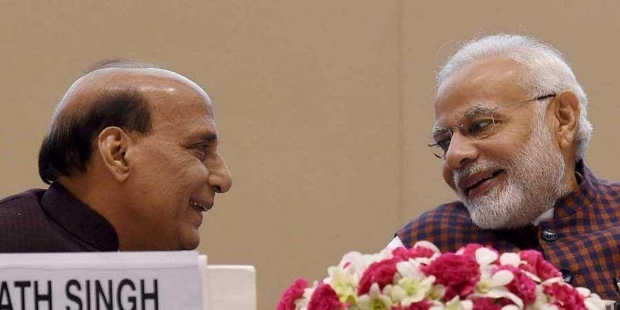Prime Minister Narendra Modi with Defence Minister Rajnath Singh. (Photo | File, PTI)