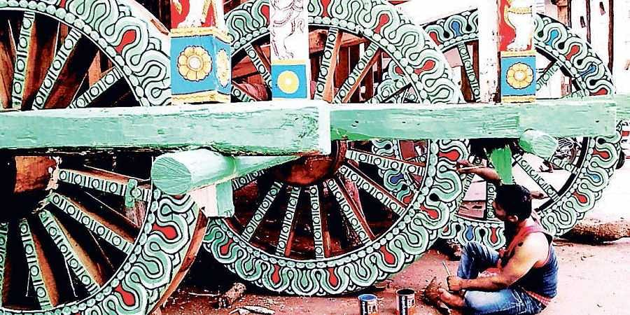 An artist painting a chariot ahead of Rath Yatra in Puri.
