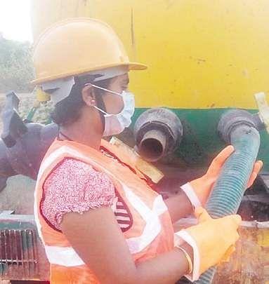 Dasari Sravani cleaning a septic tank.