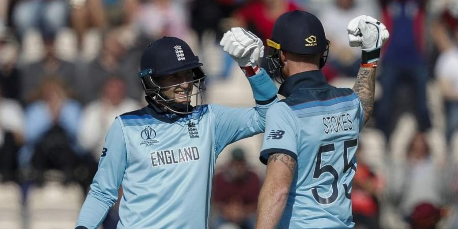 England's Joe Root (L) and England's Ben Stokes celebrate after victory in the 2019 Cricket World Cup group stage match between England and West Indies at the Rose Bowl in Southampton