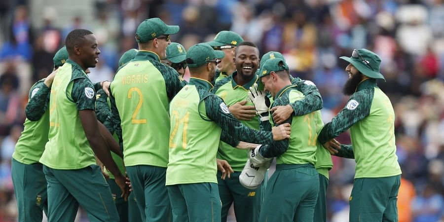 South Africa's wicketkeeper Quinton de Kock is congratulated by his teammates after taking a catch. (Photo | AP)