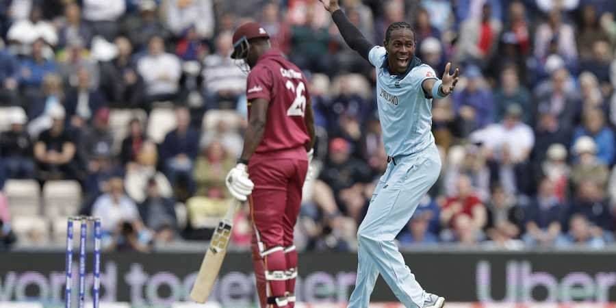 England's Jofra Archer, right, celebrates taking the wicket of West Indies' Carlos Brathwaite, left, during the Cricket World Cup match between England and West Indies at the Hampshire Bowl in Southampton. (Photo | AP)