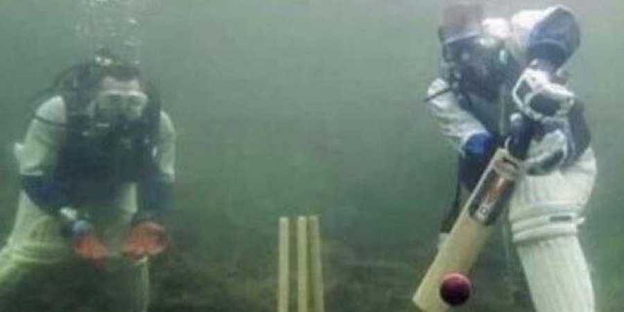 In the picture, people can be seen playing cricket underwater. (Photo | Twitter)
