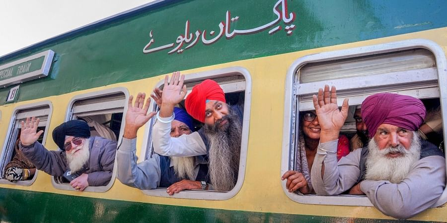 Attari Sikh pilgrims wave from a special train as they leave for Pakistan from Attari Railway Station.  (Photo | File, PTI)