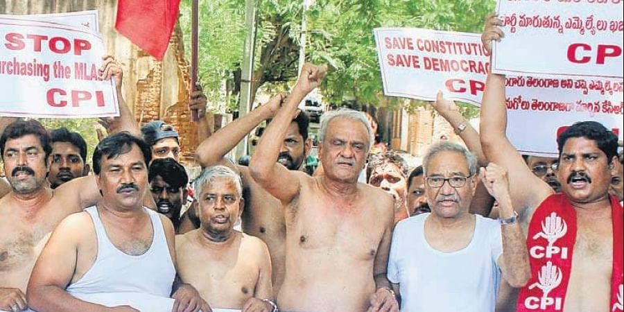 CPI members stage shirtless protest against the defection of MLAs in Hyderabad.
