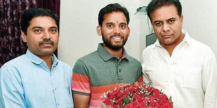 Mountaineer Amgoth Tukaram with KT Rama Rao in Hyderabad.