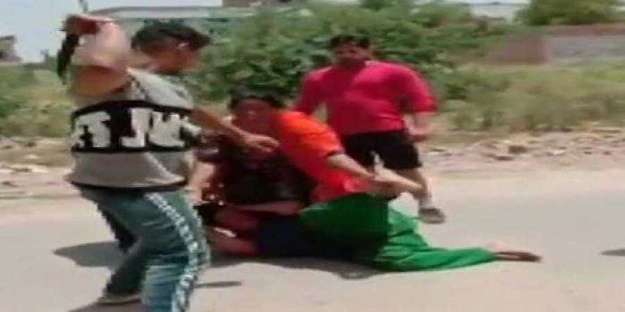 A screenshot from the video shows the woman being assaulted