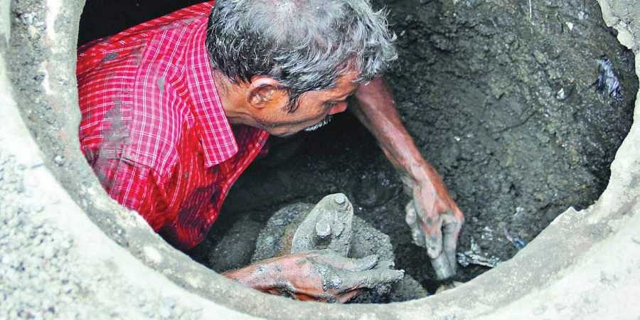 A sewage worker in Hyderabad. | EPS