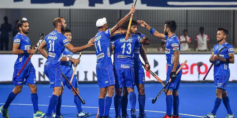 India's Harmanpreet Singh 13 being greeted by teammates after scoring a goal against South Africa