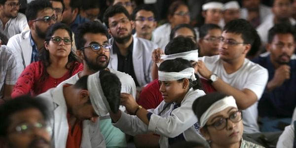 Members of Resident Doctors Association RDA of AIIMS wearing bandages on their heads protest to show solidarity with their counterparts in West Bengal who stopped work on Tuesday protesting against the assault on their colleagues in New Delhi on Friday June 14 2019. | (Shekhar Yadav | EPS)